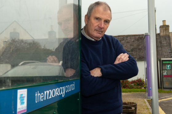 Alan Clarke at a bus stop in Garmouth.