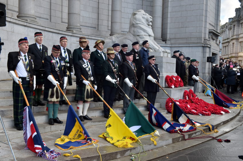 Veterans, Reserves and Cadets and Pipe Band parade marches off from Belmont Street and full parade arrived at the War Memorial.  Picture by KENNY ELRICK
