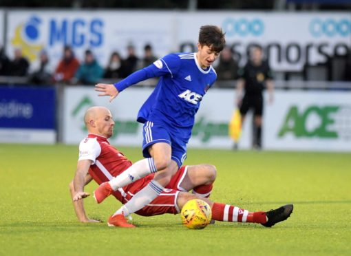 Cove's Declan Glass and Stirling's Kevin Nicol. Picture by Kath Flannery