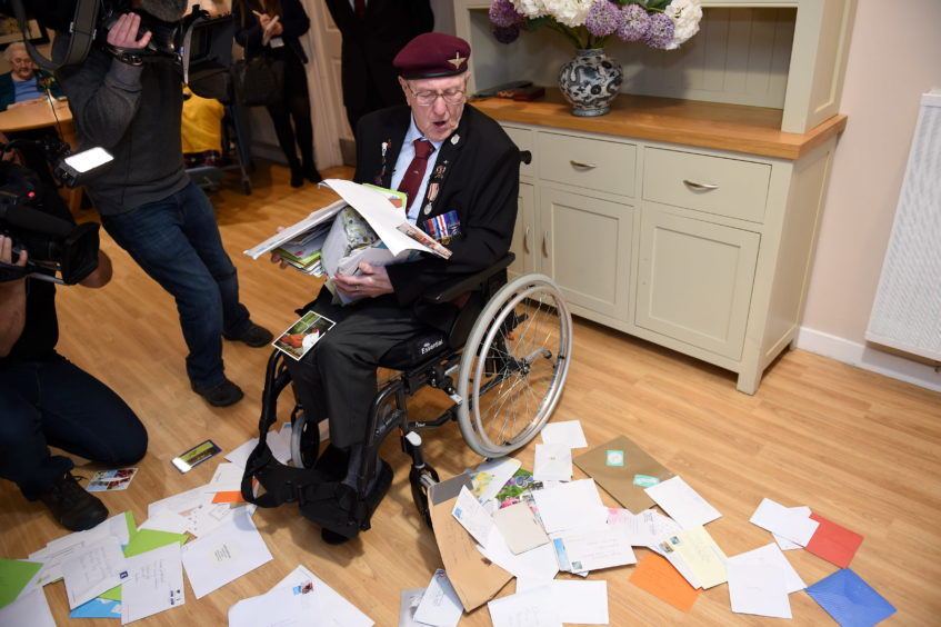 Sandy Cortmann surrounded by 350 letters sent to him by viewers of Gelderland TV Netherlands   Picture by Paul Glendell