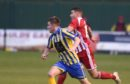 Scott Lisle on the attack for Formantine takes on Inverurie's Calum Dingwall Picture by Paul Glendell