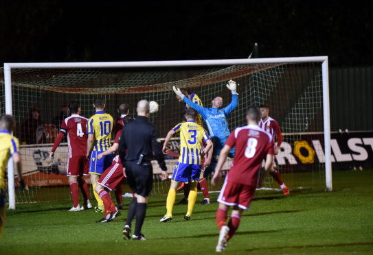 Jonny Smith opens the scoring.  Picture by Scott Baxter