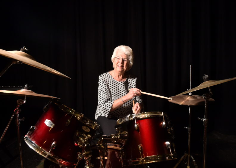 Peggy Finnie, of Finnie's the Jeweller, has donated musical instruments to St Machar Academy after her anniversary.