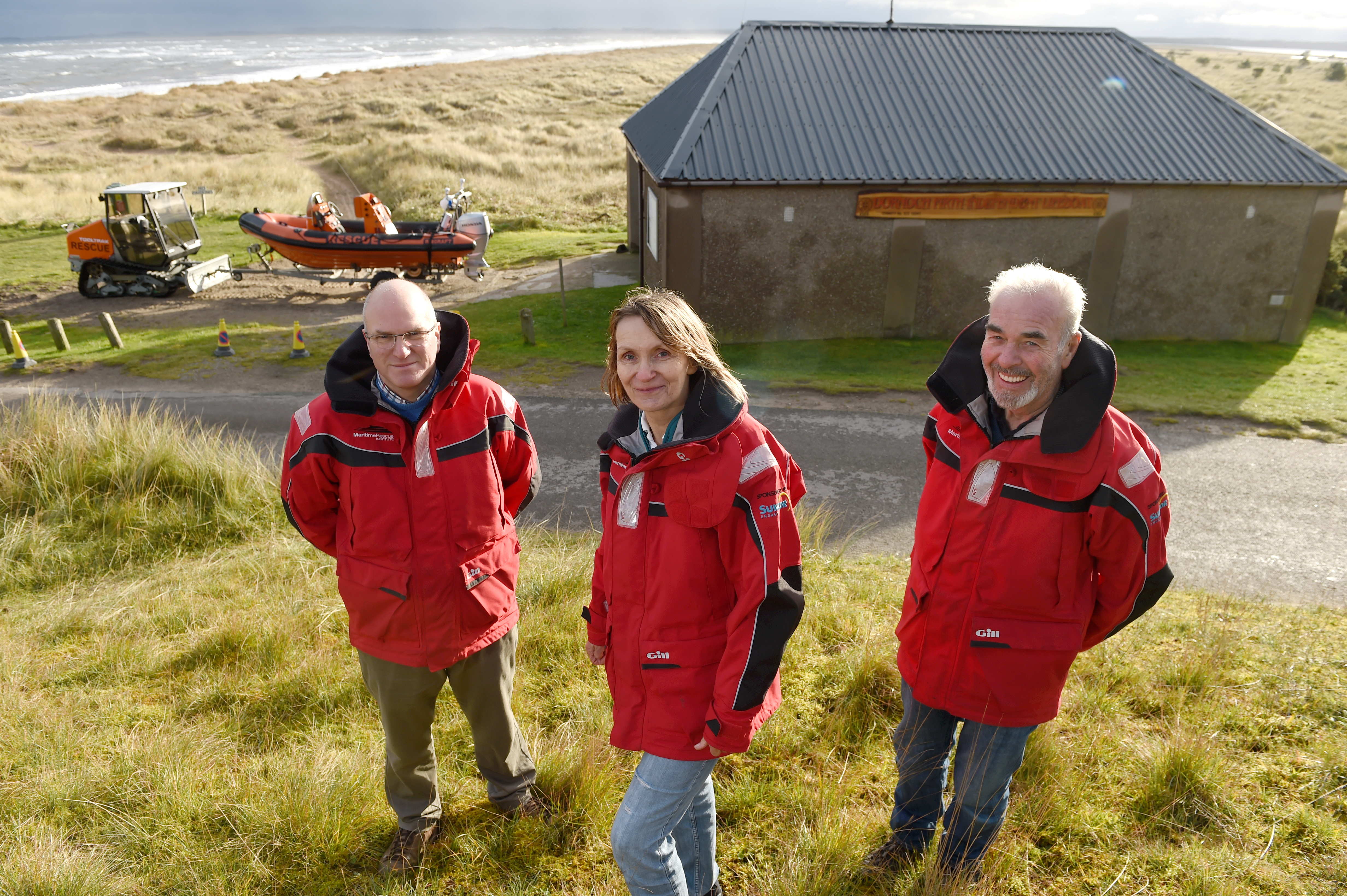 East Sutherland Rescue Association trustees (l-r) Antony Hope, Christine Graham and Alister Scobbie at their current base and on Dornoch Beach. Picture by Sandy McCook
