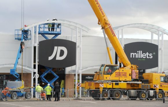 Work to remove glass panels from canopies above the walkway of the Inverness Business and Retail Park in 2017. Picture by Sandy McCook