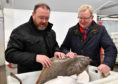 David Duguid candidate David Duguid inspect a freshly landed halibut during a visit to Fraserburgh fishmarket.