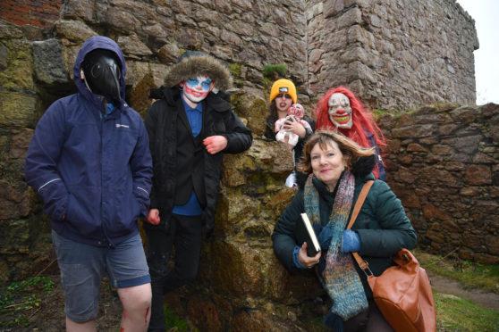 Author Alex Nye with Slains Primary pupils, Fraser Leuchars, Stanley Grasham, Neave Kinghorn and Martha Crockett hoping to get some storytelling inspiration at Slains Castle
