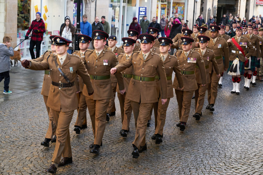Forces march during Remembrance Sunday parade in Elgin