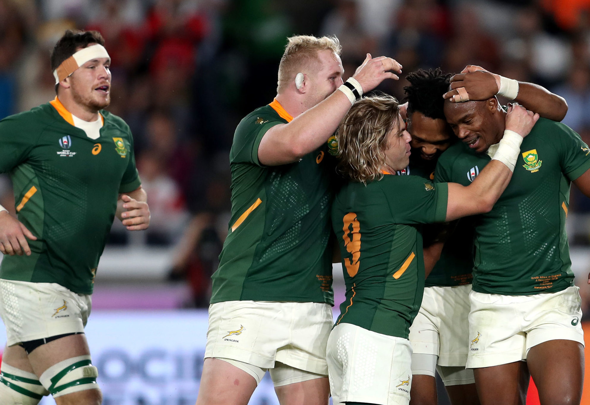South Africa's Makazole Mapimpi (right) celebrates with team-mates after scoring his side's first try of the game during the 2019 Rugby World Cup final.