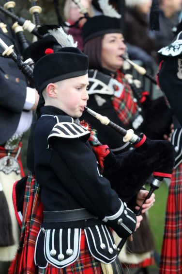 Young member of the Royal British Legion pipe band.