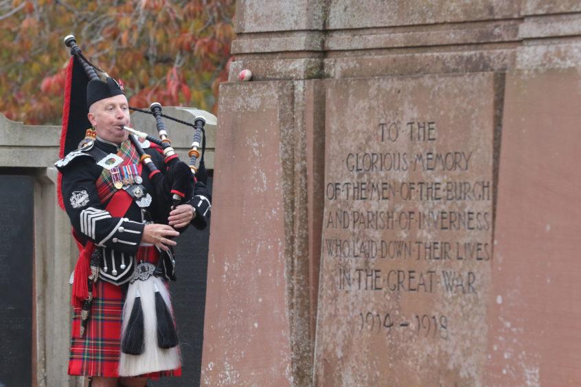 Pipe Major Gordon Straube of the Royal British Legion pipe band.