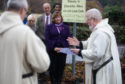 The Pluscarden Abbey car park was blessed with prayer and holy water during a visit by Scottish Government minister Fiona Hyslop.