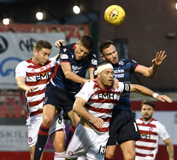 The two sides contest the ball in the air during the Ladbrokes Premiership match between Hamilton and Ross County
