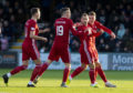 Aberdeen's Niall McGinn celebrates scoring to make it 1-1 with team-mates during the Ladbrokes Premiership match between Ross County and Aberdeen at the Global Energy Stadium.
