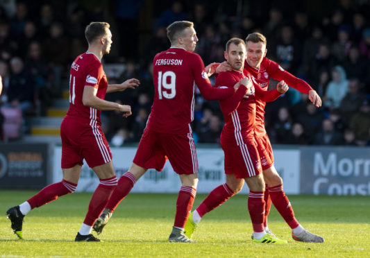 Aberdeen's Niall McGinn celebrates scoring to make it 1-1 at Ross County