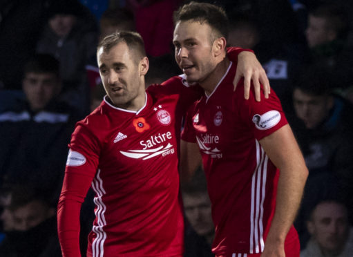 Aberdeen's Andy Considine, right, celebrates his goal at Ross County with Niall McGinn.