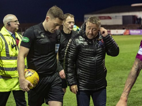 Inverness CT manager John Robertson (R) speaks with referee John Beaton at full-time.