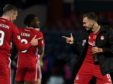 Aberdeen's Lewis Ferguson celebrates at full time with team mate Ryan Hedges (R) during the Ladbrokes Premiership match between Ross County and Aberdeen
