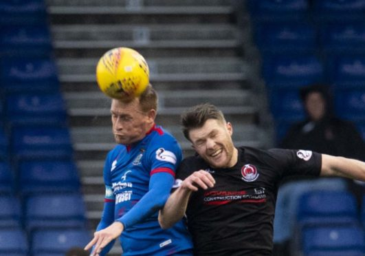 Inverness's Carl Tremarco (L) beats Clyde's Tony Wallace to the ball during the Tunnock's Caramel Wafer Challenge Cup Quarter Final match between Inverness CT and Clyde