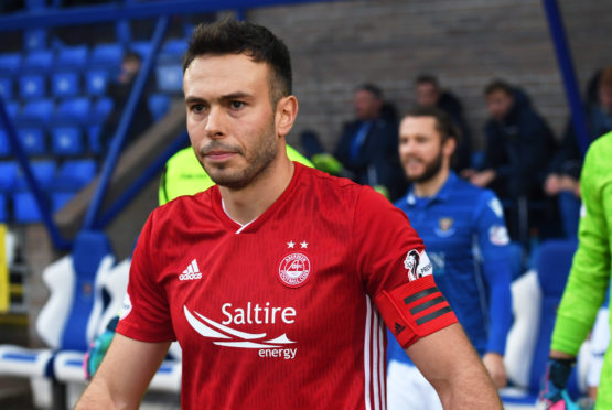 Aberdeen's Andrew Considine leads the team out at McDiarmid Park for his 500th club appearance.