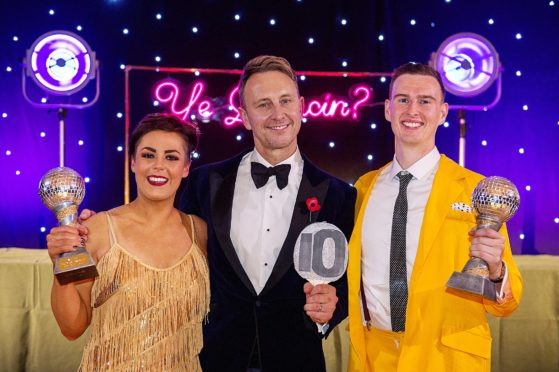 Tara MacBeath (25) and her partner Andrew Ross (26) with Strictly Come Dancing's Iain Waite.
