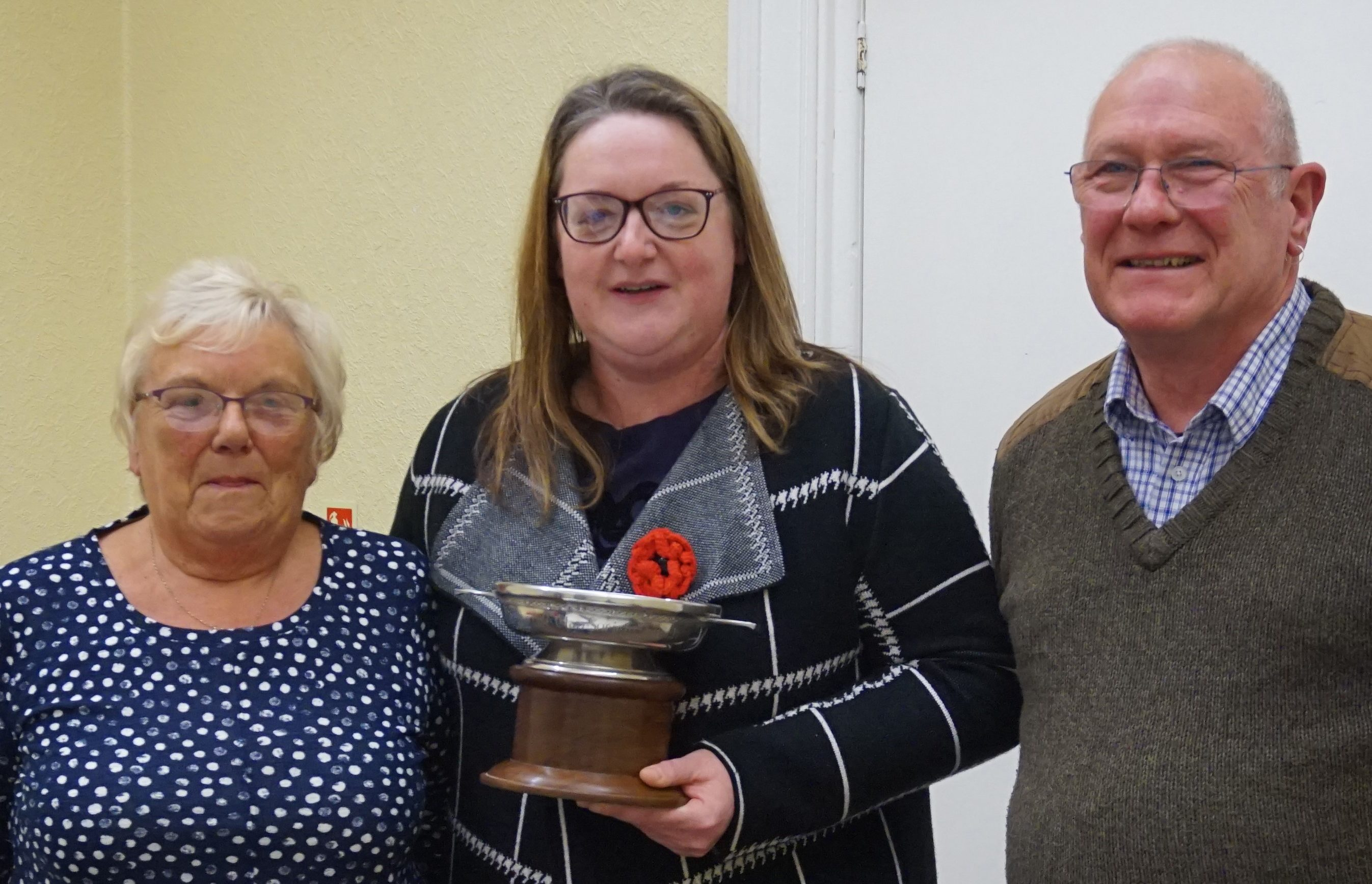 The Macduff Quaich 2019 being presented to Claire Nicholson by Banff and Macduff Community Council chairwoman Kathleen Mustard and community councillor Richard Menard