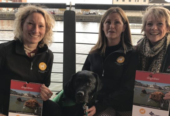 Alex the Assistance Dog with Nadia Sutherland (Dementia Specialist), Fiona Corner (Project Manager)  and Margaret Reynolds Owner of Dogrobes