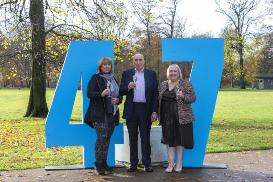 Pictured: local winners Libby Elliot and Fred and Lesley Higgins at a Lottery funded venue to celebrate the number of Lottery millionaires that have been created since it started 25 years ago.