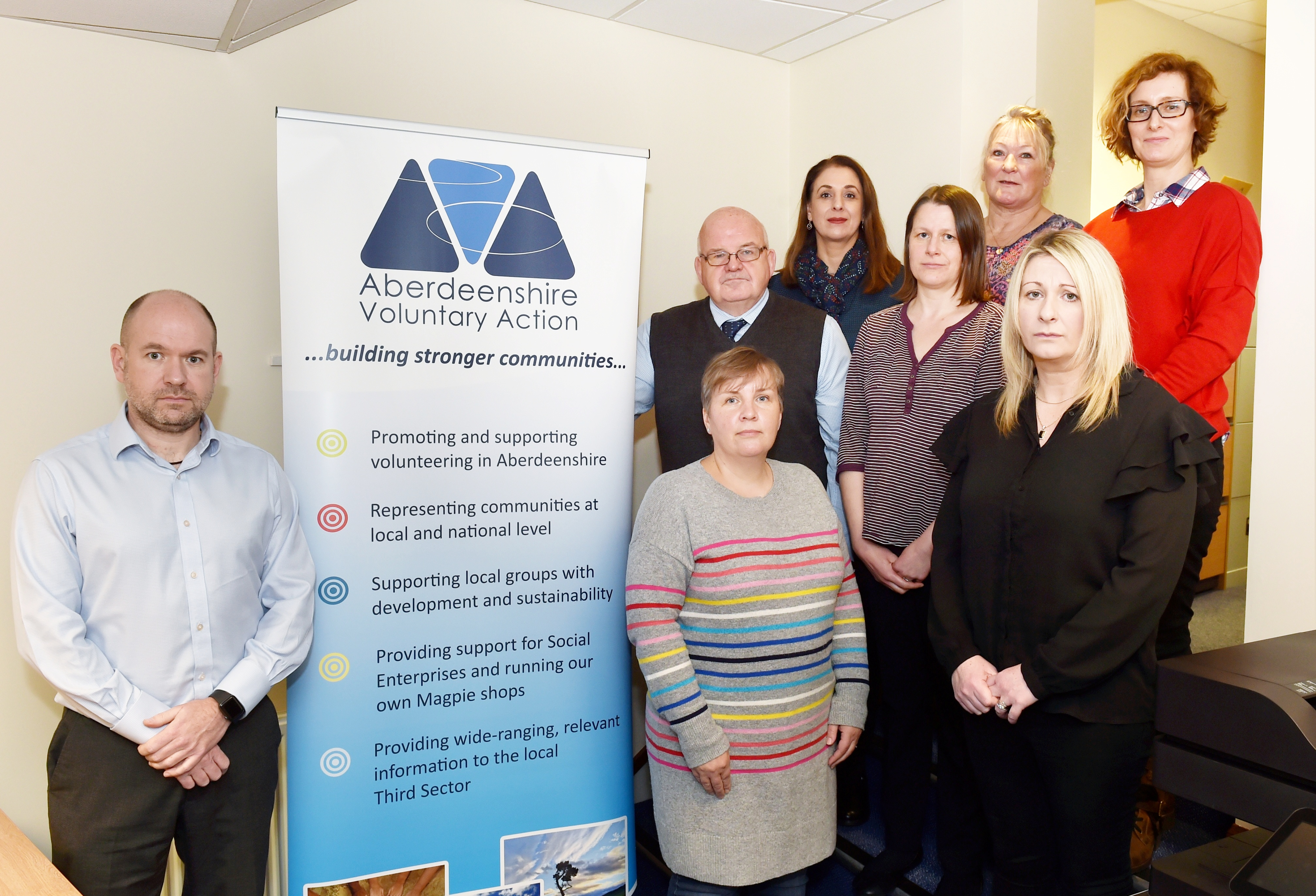AVA chief executive Dan Shaw (left) and staff (back, from left) Sandra McGuigan, Lorna Sandison, Rhona Davidson. (middle) Keith Anderson, Donna Speed and Isabelle Taylor. (front) Aileen Longino. Picture by COLIN RENNIE
