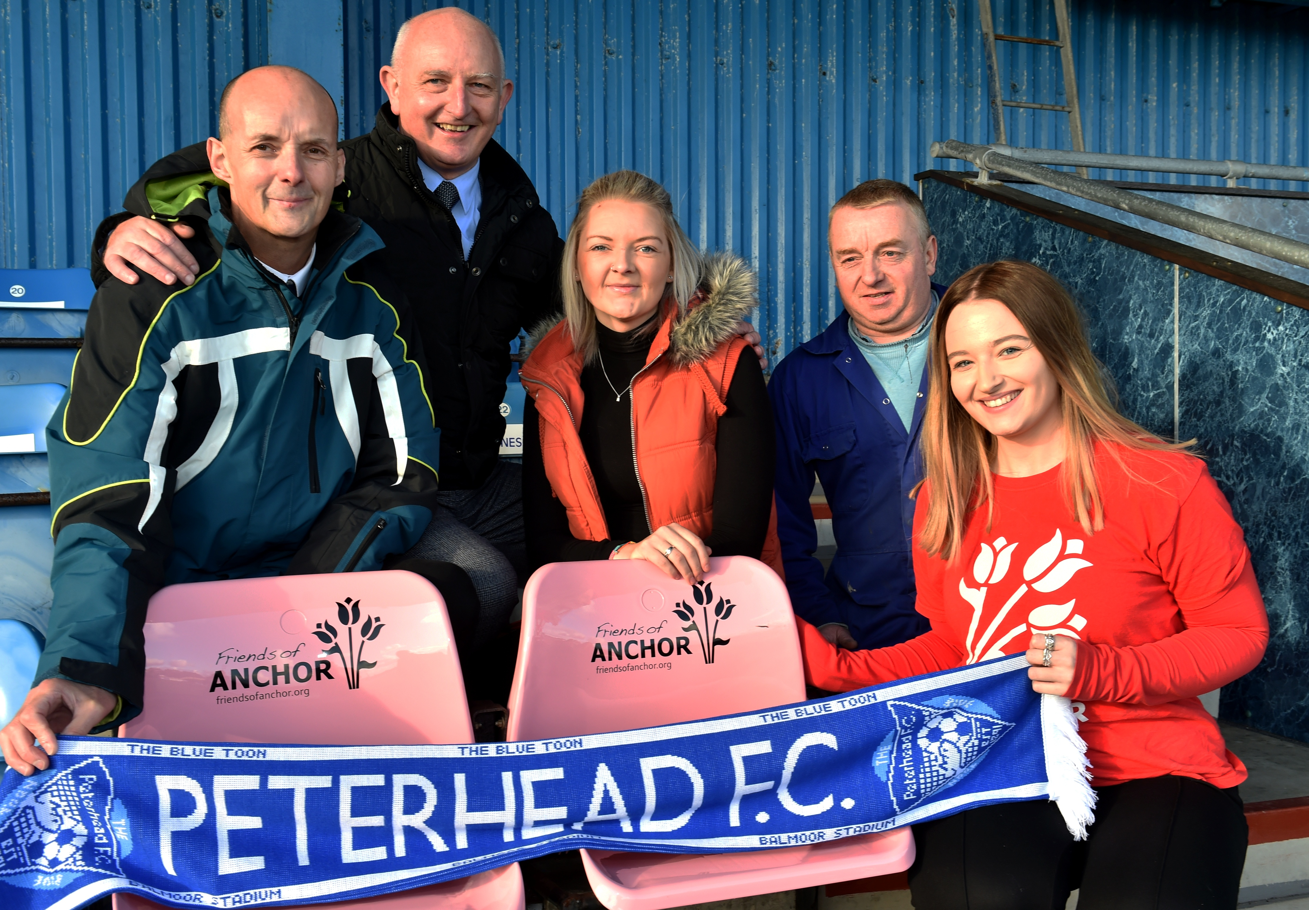 From left: Sonny Milne, Peterhead General Manager Martin Johnston, Louise Milne, Neil Daniel (who painted the seats) and Friends of Anchor Naomi Forrest. Picture by COLIN RENNIE