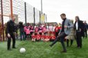Cruyff Court - Neal Cooper was officially opened adjacent to Tullos Primary School. Alex Cooper strikes the ball towards goal keeper Jim Leighton. Picture by COLIN RENNIE