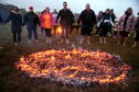 Afire walk at Barclay park in aid of Shape Up Peterhead.   Pictures by Jim Irvine