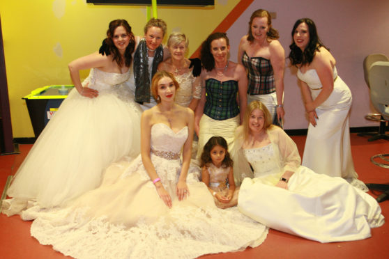 Ladies who got a chance to wear their wedding dress again at the Wedding Dress Ball in the Nevis Centre in Fort William.