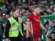 Sam Cosgrove of Aberdeen walks towards the tunnel after being sent off by Referee Euan Anderson