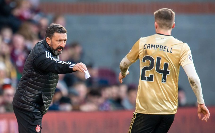 Aberdeen manager Derek McInnes passes a note to Dean Campbell (#24) of Aberdeen FC during the Ladbrokes Scottish Premiership match between Heart of Midlothian FC and Aberdeen FC