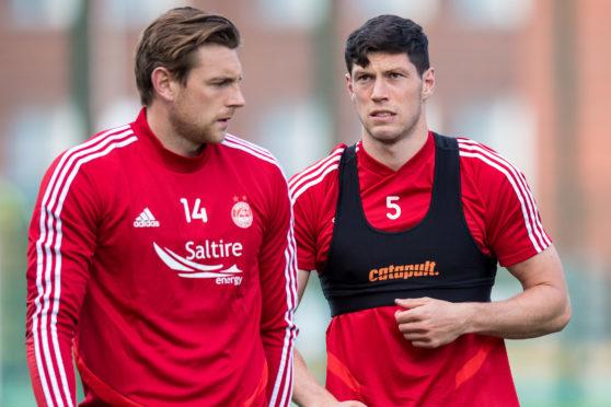 Aberdeen defenders Ash Taylor and Scott McKenna.
