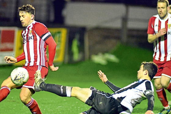 Fraserburgh's Willie West and Formartine's Stuart Anderson. Picture by Chris Sumner