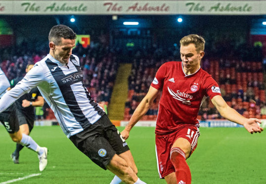 Aberdeen's Ryan Hedges (R) in action with St Mirren's Paul McGinn