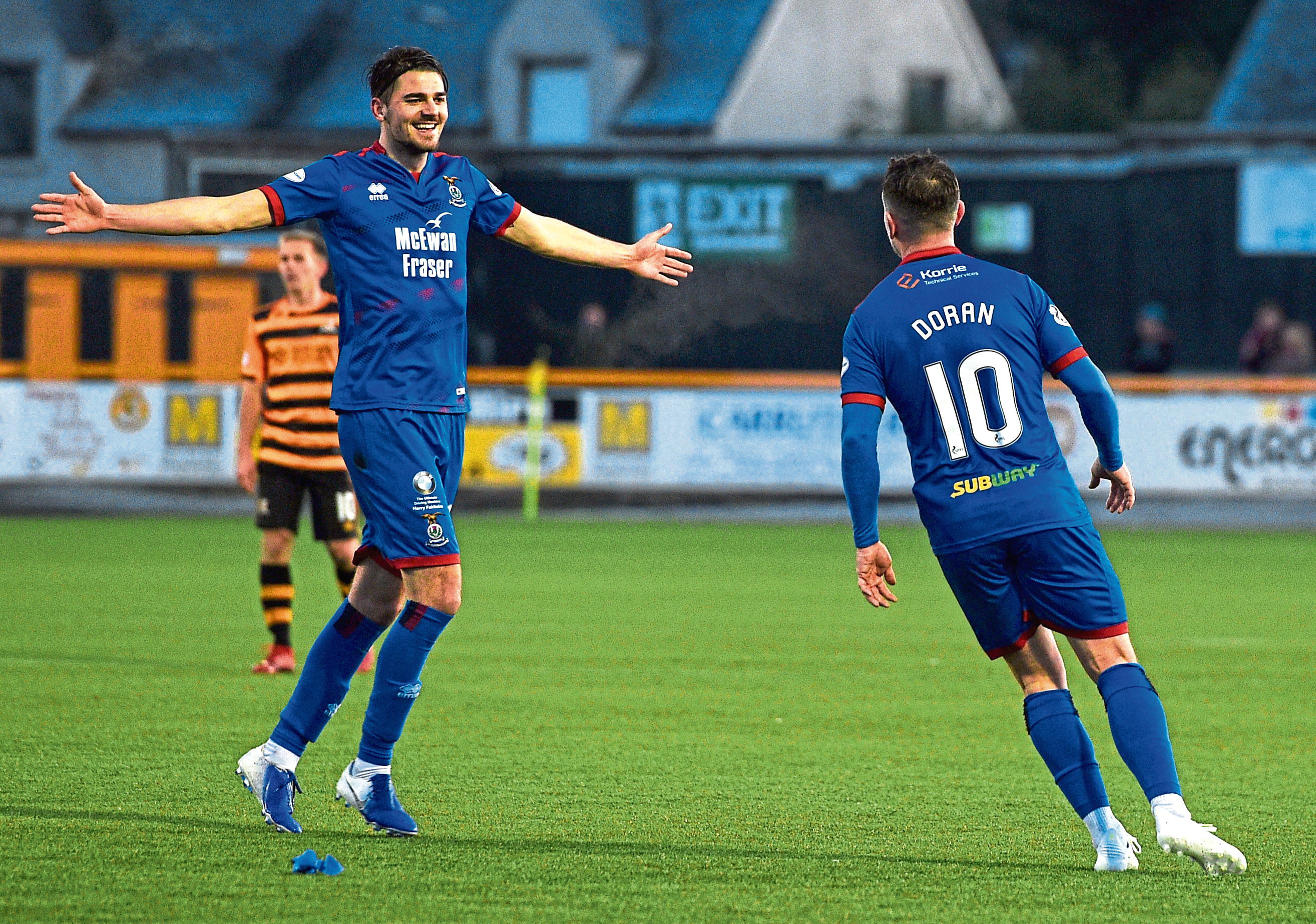 Inverness' Charlie Trafford, left, celebrates with goalscorer Aaron Doran