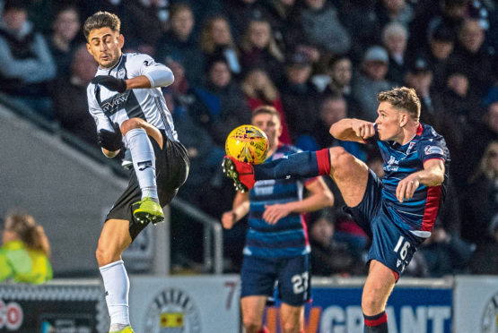 Lewis Spence in action for Ross County.