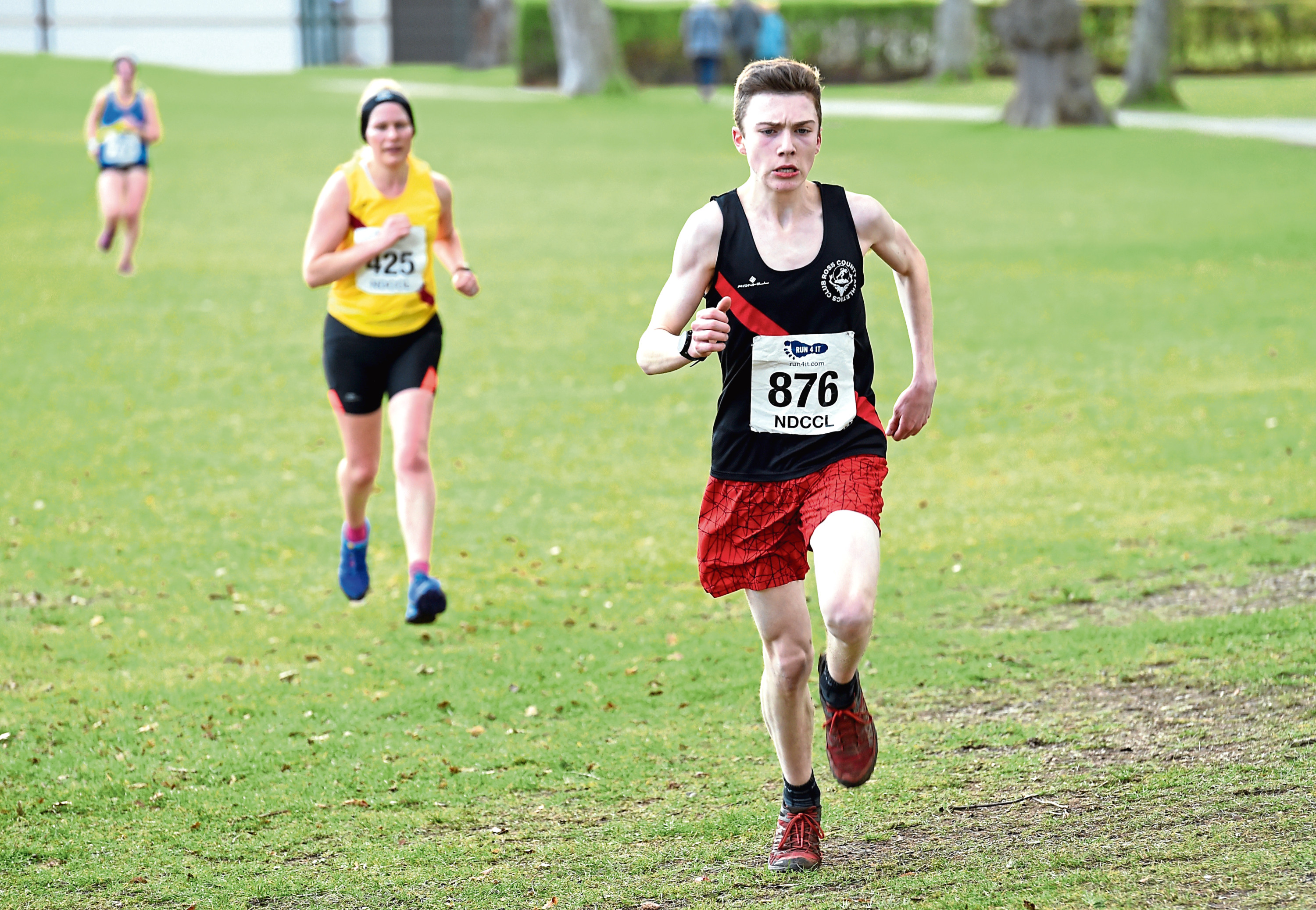 Hamish Hickey crossing the finishing line first competing in the cross country at Grant Park in Forres.