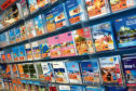 Generic view of holiday brochures. Thompson travel and First Choice are companies part of TUI Travel's portfolio.