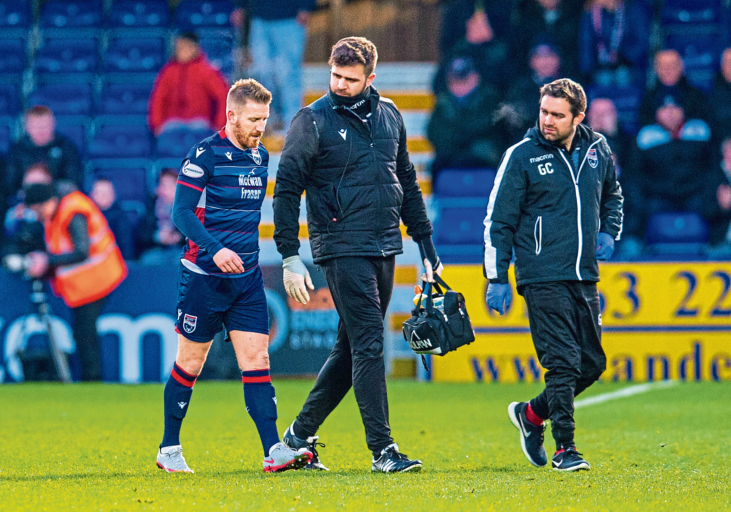 Michael Gardyne goes off injured during the Ladbrokes Premiership match between Ross County and Kilmarnock.