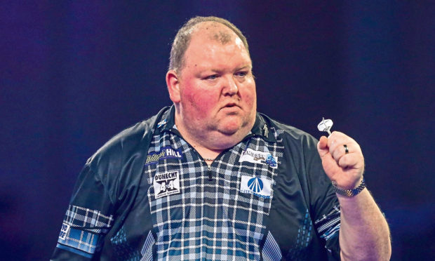 John Henderson wins his second round match against James Richardson during the PDC William Hill World Darts Championship at Alexandra Palace, London