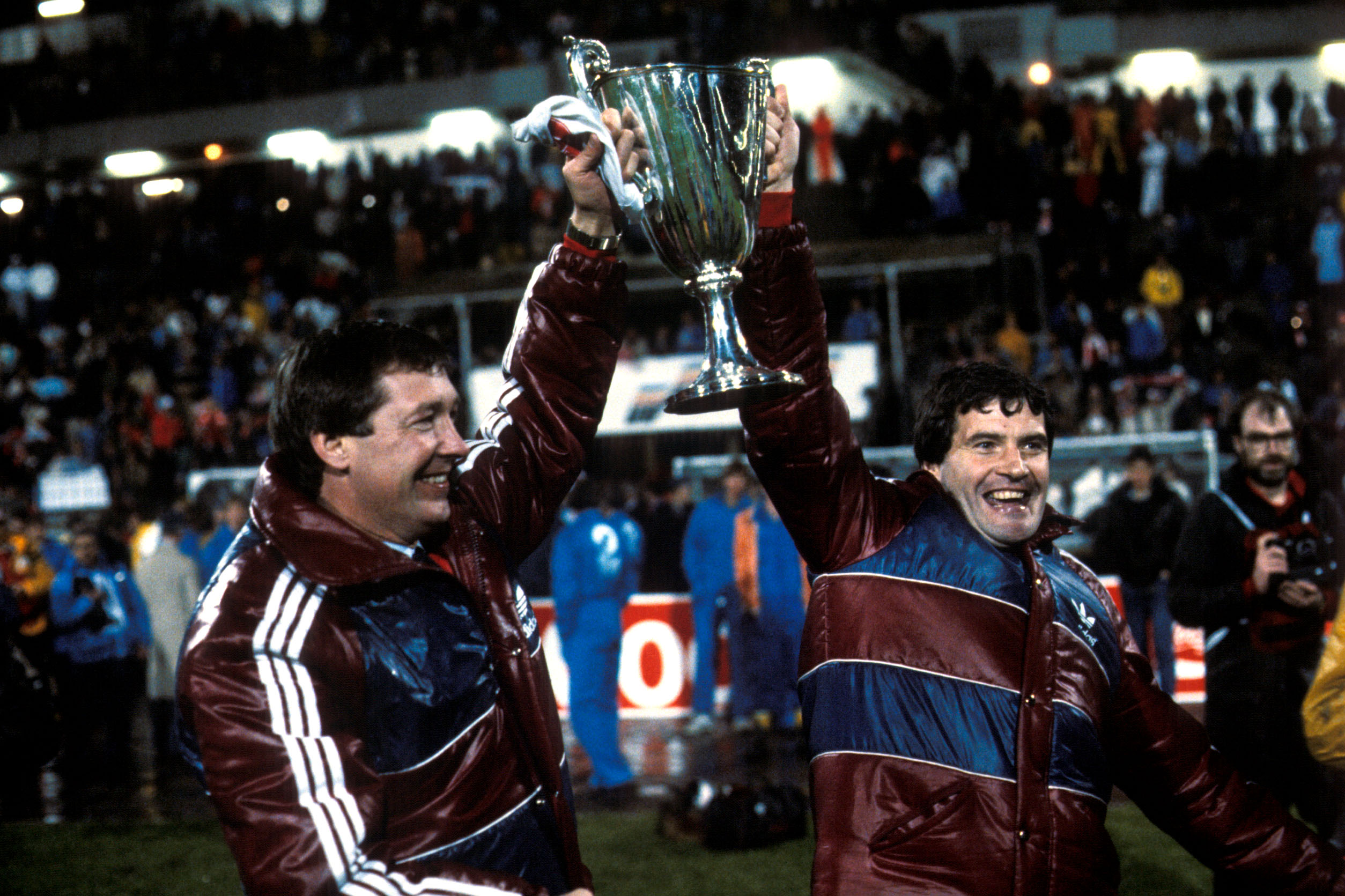 Aberdeen manager Alex Ferguson (left) and assistant Archie Knox celebrate with the trophy in Gothenburg in 1983.