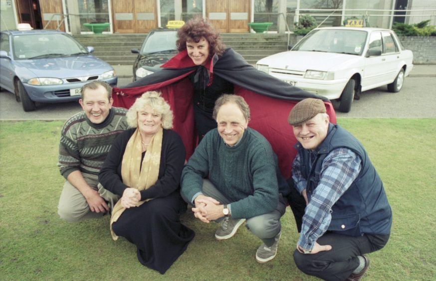 Henrietta Edwards of Elgin Amateur Dramatic Society, with taxi drivers Willie Duncan, Isobel Prideaux, David Reid and social worker John Sullivan in 1997