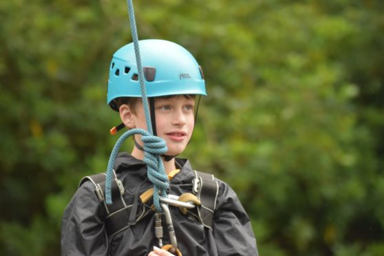 Archie Rough, 10, has earned all of his Cub Scout badges
