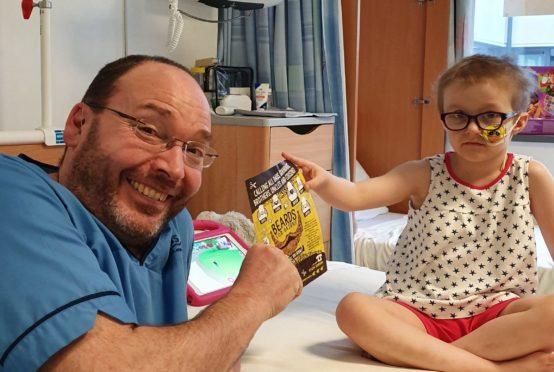 Six-year-old patient Etta nominates senior staff nurse Guy Wilson to grow a beard for Beard for Bairns.