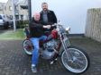 Winner James Cruickshank, on the bike, with Area Manager, Gordon Cruden,