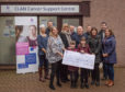Staff from Leys Group and family members of Irene Steel donate to Clan